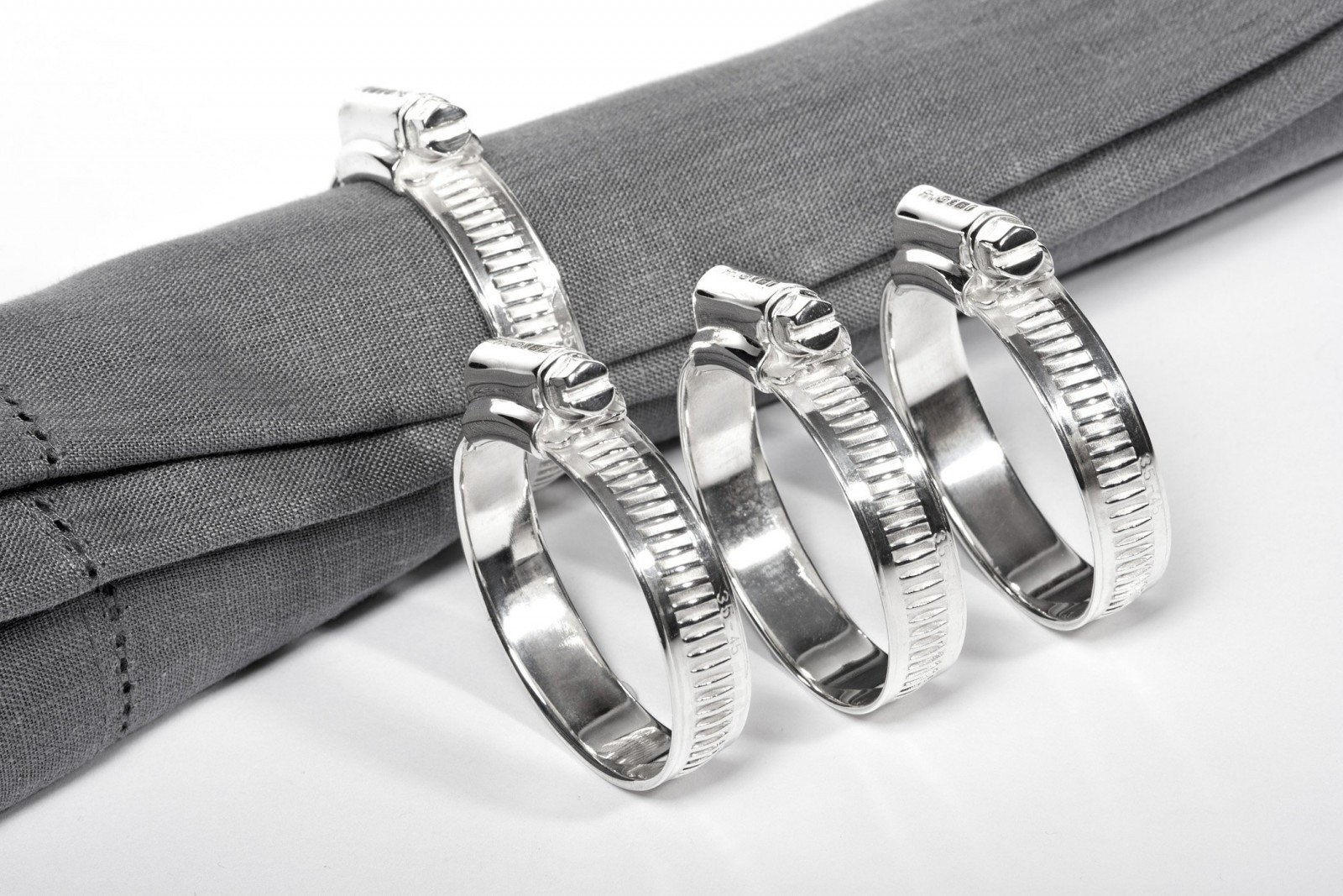 Silver Cable Tie Napkin Rings by Rebecca Joselyn Silversmith and Jeweller handmade in Sheffield South Yorkshire